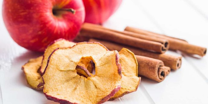 Dried apple slices and cinnamon.