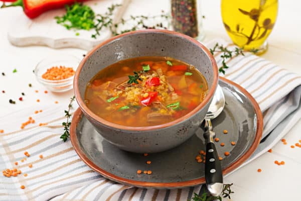 Appetizing soup with red lentils, meat, red paprika and fragrant