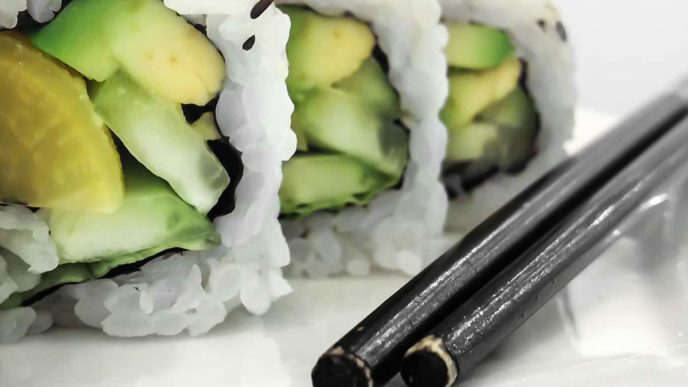 Green vegan sushi rolls with vegetables