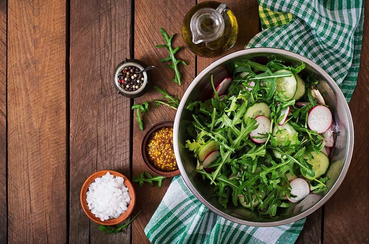 Ingredients for Salad arugula, radish, cucumber and spices. Top