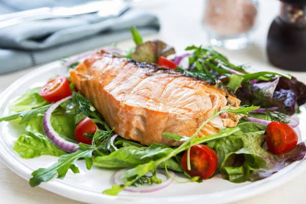 Salmon steak with salad