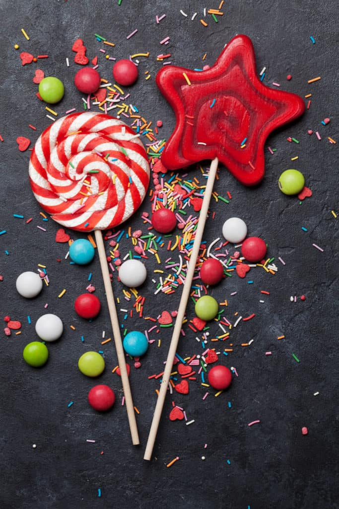 Colorful sweets. Lollipops and candies. Top view