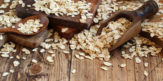Rolled oats on a wooden table