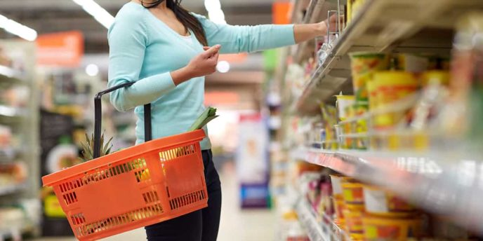 Woman Checking Gluten Free Labelling at Grocery Store