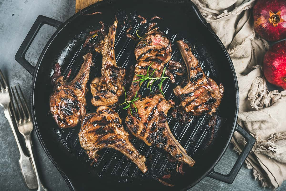 Barbecue dinner with grilled lamb meat chops in pan