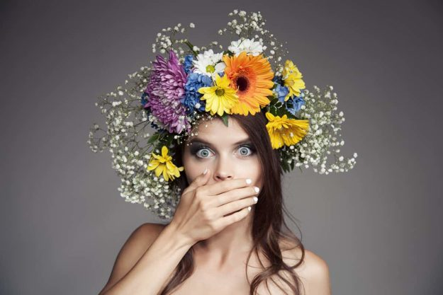 Surprised Woman With Flower Wreath On Her Head.
