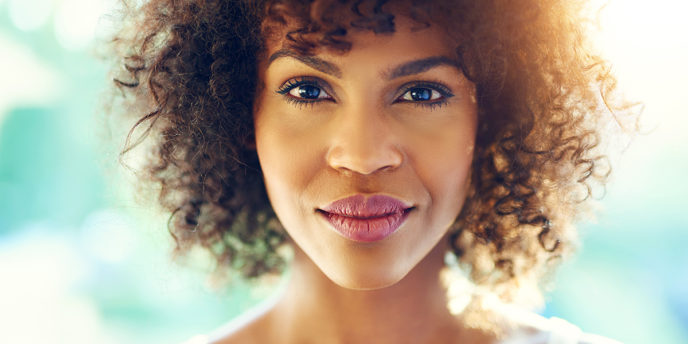 Woman Similing because she knows the sings of gluten sensitivity