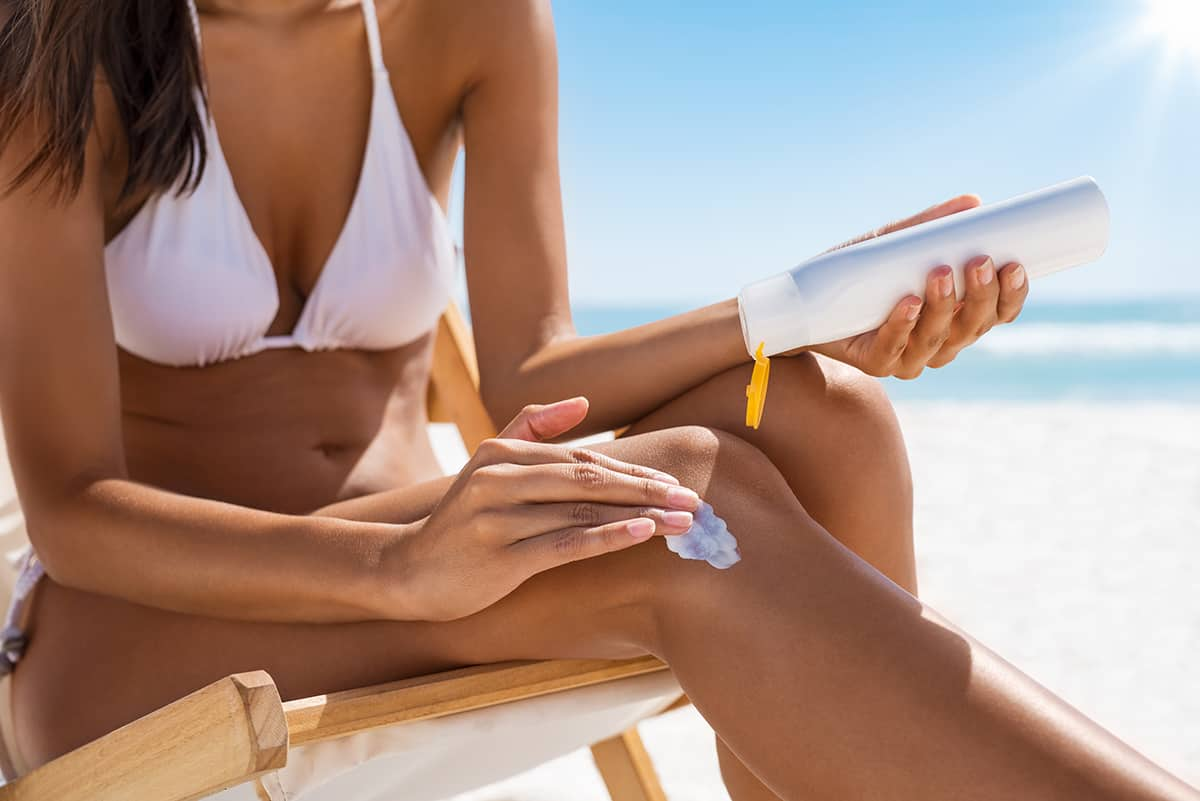 Woman applying sun screen