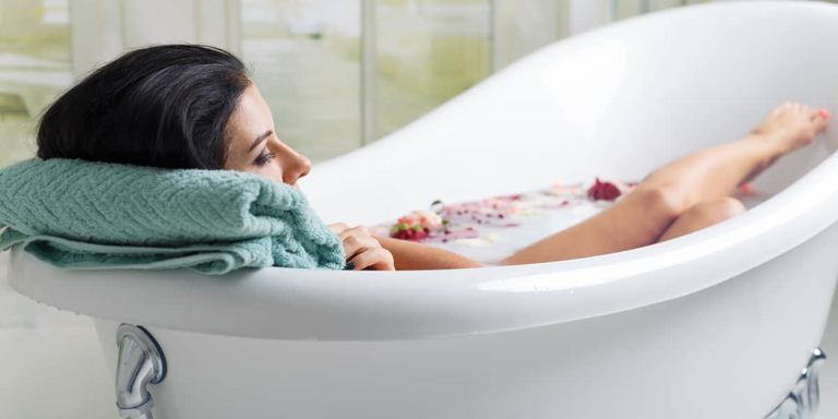 Woman taking bath for skin